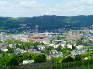 Trier as seen in summer 2012 (structures left to right: Imperial Basilica from the 300s, Citizen Church from the 1300s, Cathedral foundations dating back to 300s)
